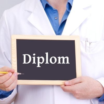 Doctor shows information on blackboard: diploma